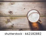 beer mug on an old wooden table....   Shutterstock . vector #662182882