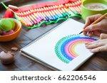 girl draws a rainbow. positive...