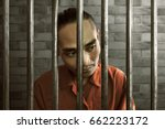 asian man in prison | Shutterstock . vector #662223172