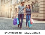 young couple tourists city... | Shutterstock . vector #662228536
