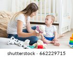 baby boy playing on floor at... | Shutterstock . vector #662229715