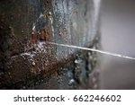 rusty burst pipe spraying water ... | Shutterstock . vector #662246602