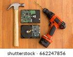 hammer hard drives and drill | Shutterstock . vector #662247856