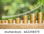 Small photo of Tree growing on one dollar coins arranged as a graph on wood table with white arrow indicates economic upturn and natural bokeh background, concept of finance growth and saving money