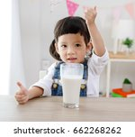 preschooler girl drinking some... | Shutterstock . vector #662268262