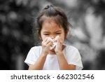 sick little asian girl wiping... | Shutterstock . vector #662302546