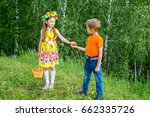 a cute girl gives an apple to a ... | Shutterstock . vector #662335726