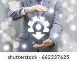 businessman offers gear arrow... | Shutterstock . vector #662337625