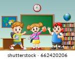 happy school kids in a classroom | Shutterstock . vector #662420206
