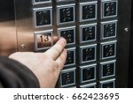 hand presses the button on the... | Shutterstock . vector #662423695