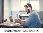 young man with a headphones | Shutterstock . vector #662428615