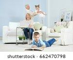 grandson looking through photo... | Shutterstock . vector #662470798