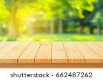 wood floor with blurred trees... | Shutterstock . vector #662487262