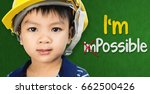 Small photo of Boy wearing engineering hat with Im possible text for Educational and occupation possibility concept