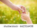 the father gives the child a... | Shutterstock . vector #662516458