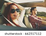 car trip and two lovers  | Shutterstock . vector #662517112