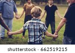 group of people holding hands... | Shutterstock . vector #662519215