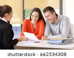 saleswoman talking with a... | Shutterstock . vector #662534308