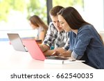 two concentrated students... | Shutterstock . vector #662540035