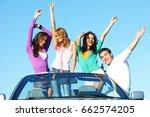 funey friends dance in car at... | Shutterstock . vector #662574205