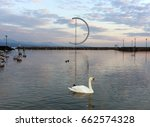 swan on geneva lake in lausanne ... | Shutterstock . vector #662574328