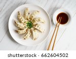 plate of Japanese gyoza, dumplings snack , with soy sauce