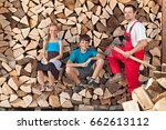 Small photo of Father and kids taking a break from chopping and stacking firewood into a wood shed