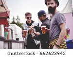 men buying the beers at the... | Shutterstock . vector #662623942