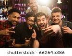 happy male friends taking... | Shutterstock . vector #662645386