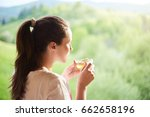 woman drink herbal tea | Shutterstock . vector #662658196