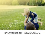 Small photo of Mother and baby playing on the grass/ summer background with mum and child