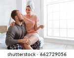 happy pregnant woman sitting on ... | Shutterstock . vector #662729056