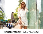 fashionable blonde woman in a... | Shutterstock . vector #662760622