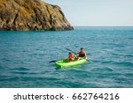 Small photo of Two happy kids kayaking on the river. Active happy twin brothers, teenage school boys, having fun together enjoying adventurous experience on a sunny day during summer vacation.