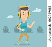 happy caucasian man running... | Shutterstock .eps vector #662769685