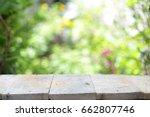 outdoor wooden table  | Shutterstock . vector #662807746