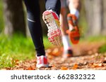 young couple jogging in park at ... | Shutterstock . vector #662832322