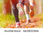 young couple jogging in park at ... | Shutterstock . vector #662832466