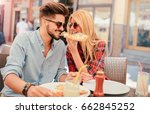 dating in pizzeria. young... | Shutterstock . vector #662845252