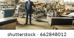 man engineer stand near saw... | Shutterstock . vector #662848012
