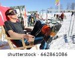 man skier drinks beer on... | Shutterstock . vector #662861086