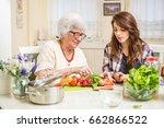 grandmother and granddaughter... | Shutterstock . vector #662866522