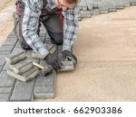 paver laying driveway pavement... | Shutterstock . vector #662903386