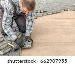 paver laying driveway pavement... | Shutterstock . vector #662907955