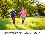the girls run and play with... | Shutterstock . vector #662925535
