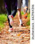 young couple jogging in park at ... | Shutterstock . vector #662964346