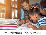 adult teach homework child at... | Shutterstock . vector #662979838