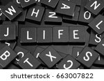 "Small photo of Black letter tiles spelling the word ""life"" on a reflective background"