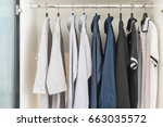 clothes hanging on rail in... | Shutterstock . vector #663035572