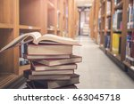 stack of books in library room | Shutterstock . vector #663045718